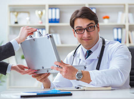 Young doctor in medical insurance fraud concept Stok Fotoğraf - 130529106