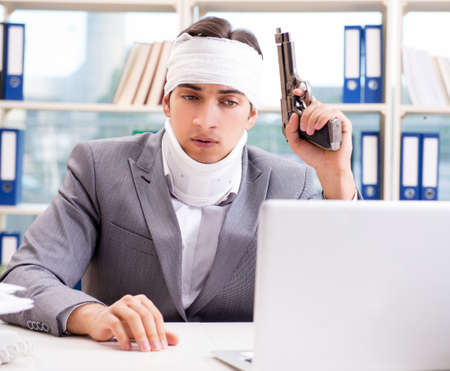 Injured businessman working in the office