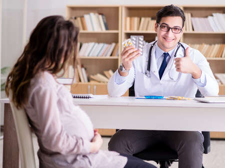 Pregnant woman visiting doctor for consultation Stock Photo