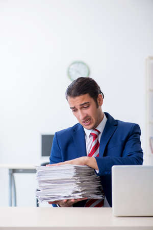 Young male businessman sitting in the office Reklamní fotografie