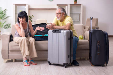 Old couple preparing for vacation travel