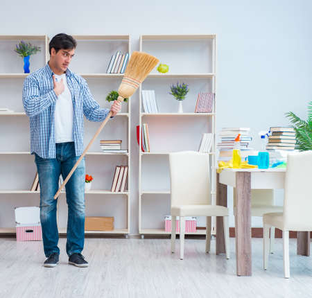 Man doing cleaning at home Stock Photo
