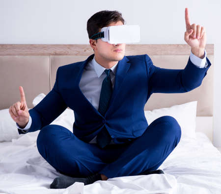 Businessman wearing a virtual reality headset in the bedroom