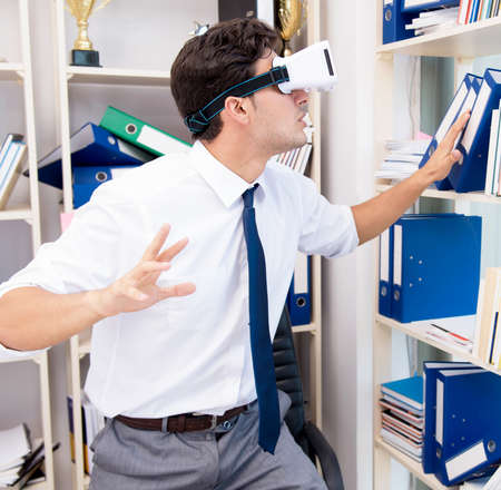 Employee watching movie on vr virtual reality glasses 写真素材