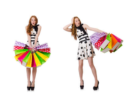 Young woman with shopping bags on white Stock Photo