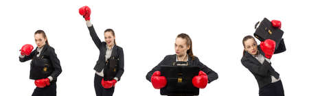The businesswoman with boxing gloves isolated on white Stock Photo