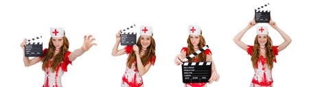 Woman doctor in bloody uniform with movie clapperboard