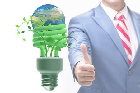 Green energy and ecology concept with the businessman Imagens