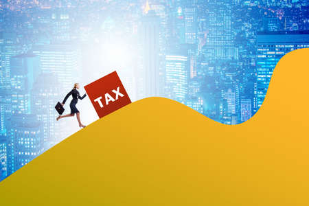 Businesswoman in tax concept on mountain