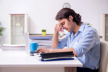 Young male employee working at home
