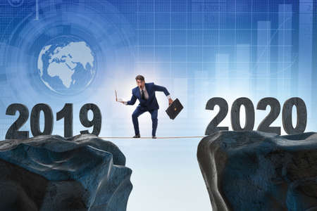 Businessman on tight rope from year 2019 to 2020