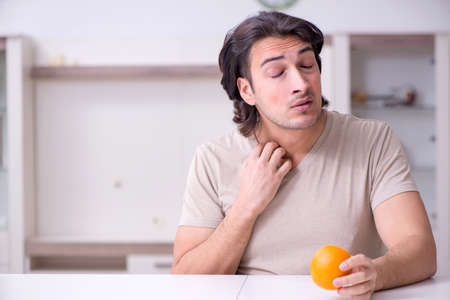 Young man suffering from allergy