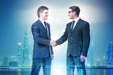 Businessman shaking hands in agreement Stockfoto