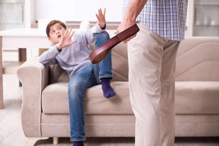 Father beating and punishing his sone Banco de Imagens