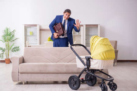 Young businessman looking after baby Stock Photo