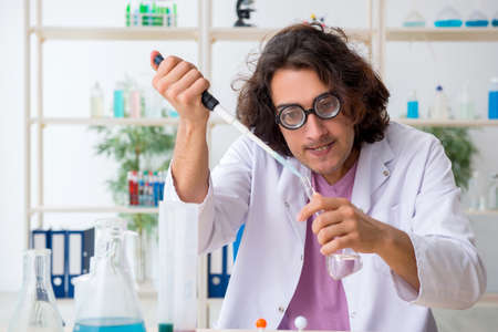 Funny male chemist working in the lab