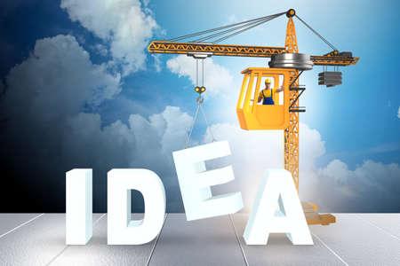 Crane lifting the word idea up Imagens