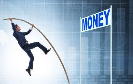 Businessman jumping over money in business concept Foto de archivo - 130812202
