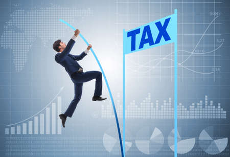 Businessman jumping over tax in tax evasion avoidance concept Foto de archivo - 130812502