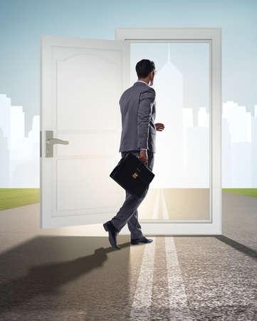Businessman in front of door in business opportunities concept Stock fotó
