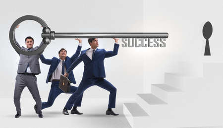 Businessmen in business success concept with key