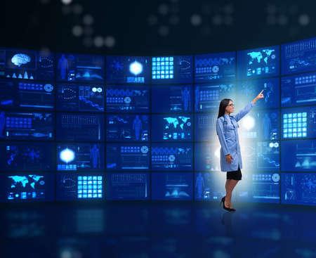 Doctor in telemedicine concept pressing buttons Reklamní fotografie