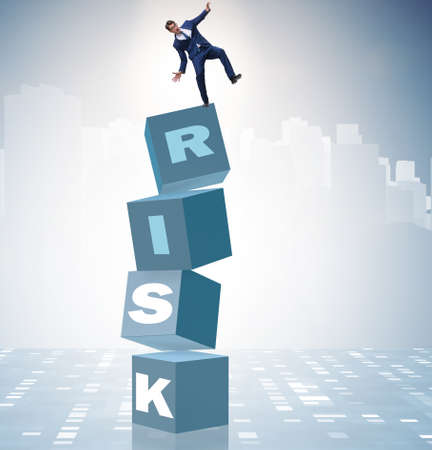 Businessman in risk and reward business concept Imagens