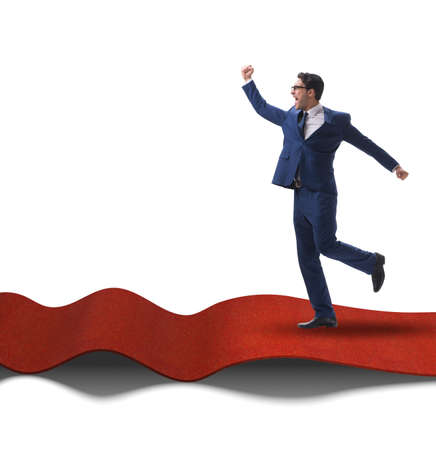 Businessman on red carpet isolated white background