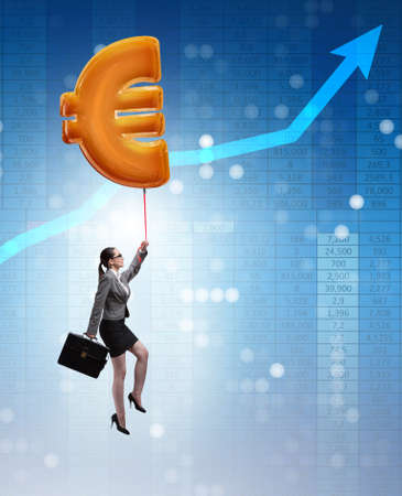 Businesswoman flying on euro sign inflatable balloon
