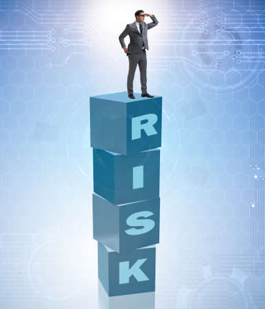 Businessman in risk and reward business concept Stock fotó