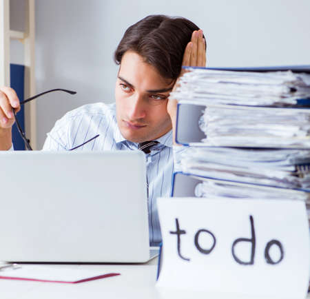Businessman failing to deliver his to-do list Stock Photo