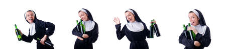 Nun with bottle of red wine Imagens