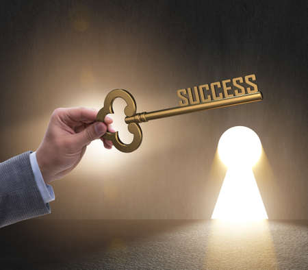 Businessman with key to success business concept Imagens