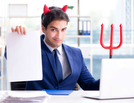 The devil angry businessman in the office