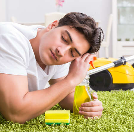 Young husband man cleaning floor at home Stock Photo