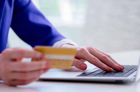 Woman buying online with credit plastic card Standard-Bild - 131460958