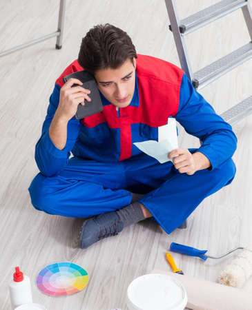 The young painter trying to match colours for painting job
