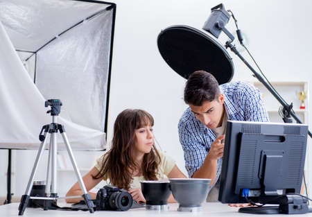 Young photographer working in photo studio Stock Photo