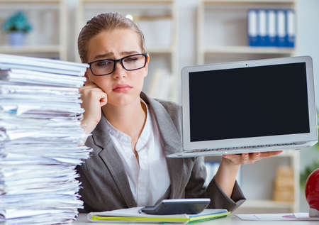 Young businesswoman accountant working in the office