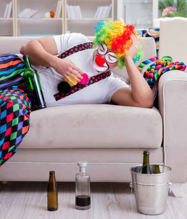 Drunk clown celebrating having a party at home Stock fotó