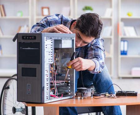 Computer repairman on wheelchair working Stok Fotoğraf