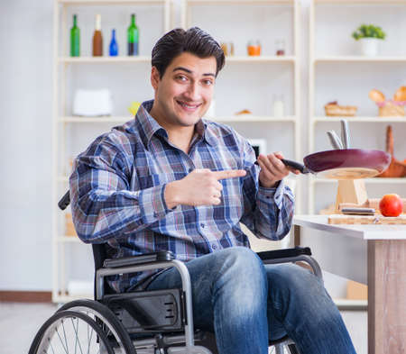 Disabled young husband frying at kitchen