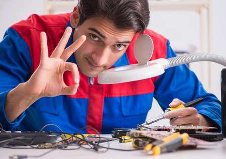 The professional repairman repairing computer in workshop