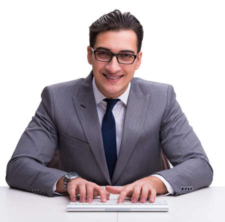 Young businessman typing on a keyboard isolated on white backgro