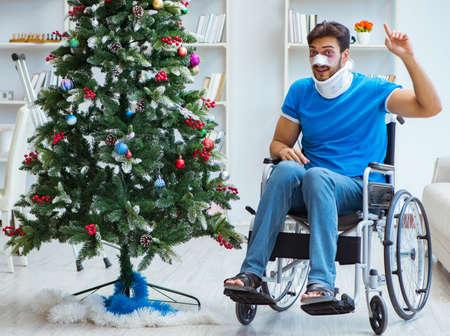 Injured disabled man celebrating christmas at home Stok Fotoğraf
