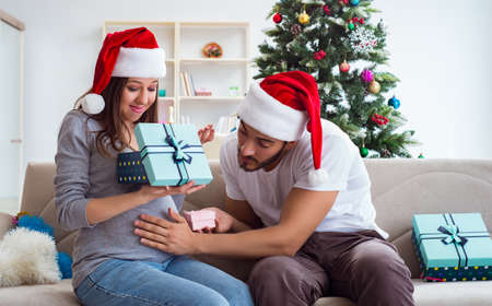Young family expecting child baby celebrating christmas Stock Photo