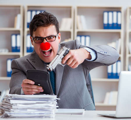 Clown businessman working in the office angry frustrated with a