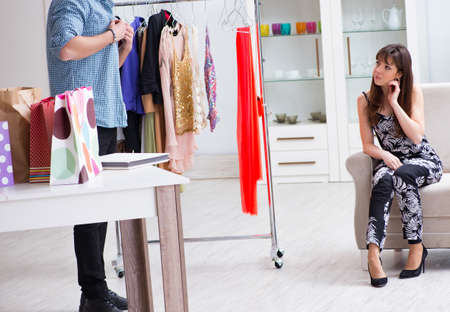 Shop assistant helping woman with buying choice Фото со стока