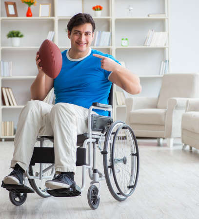 Young man american football player recovering on wheelchair Stok Fotoğraf