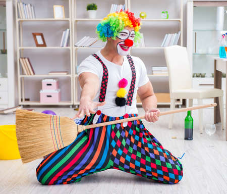 Funny clown doing cleaning at home Фото со стока - 130812053